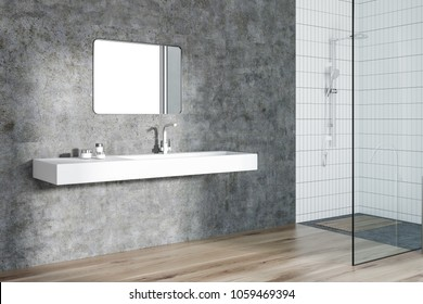 Modern bathroom interior with concrete walls, a white sink with a square mirror, a wooden floor, and a shower stall. 3d rendering mock up