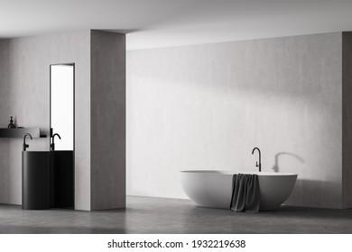 El moderno cuarto de baño con bañera blanca y lavabo de mármol con espejo vertical rectangular, de estilo eco-minimalista con suelo y paredes de hormigón. No hay gente. Representación 3D