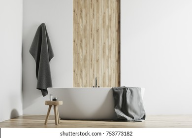 Modern bathroom interior with white and wooden walls, a large bathtub, a small chair and a towel hanging on the wall 3d rendering mock up