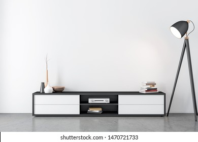 Modern bureau or tv console mockup in empty room with lamp, 3d rendering