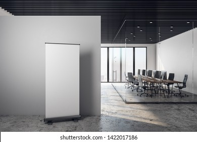 Modern coworking office interior with empty white frame on concrete wall, furniture, city view and daylight. 3D Rendering