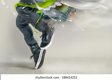 Modern dance in jeans and sneakers with splashes, splatters