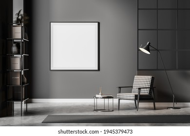 Modern dark waiting room interior including cosy armchair, glass lattice partition, empty poster on grey wall, concrete floor. Concept of contemporary minimalist design. Mock up. 3d rendering