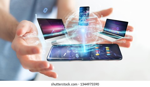 Modern devices connected to each other in businessman hand 3D rendering