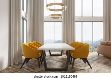 Modern dining room interior with white walls, a wooden floor and a whitte and black table with yellow chairs. A window. A side view. 3d rendering mock up