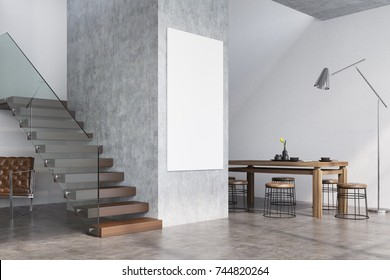 Modern dining room interior with white and concrete walls, a dark wooden table with round chairs near it, a poster and a flight of stairs. 3d rendering mock up