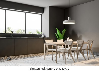 Modern dining room and kitchen corner with gray walls, a large window, a wooden floor and a table with white chairs. 3d rendering