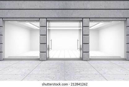 Moderna tienda vacía frontal con grandes ventanas