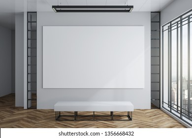 Modern exhibition hall interior with empty white banner on concrete wall, wooden floor, city view and daylight. Gallery concept. Mock up, 3D Rendering