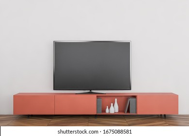 Modern flat screen TV standing on orange cabinet in stylish living room with white walls and wooden floor. Concept of entertainment. 3d rendering