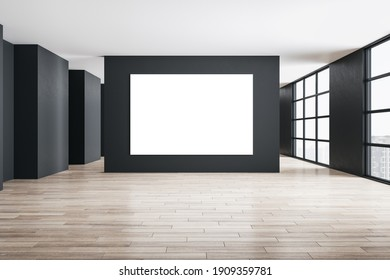 Modern gallery interior with blank white poster on wall and city view. Art and design concept. 3D Rendering