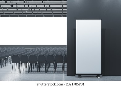 Modern grey auditorium with seating and empty screen with mock up banner for your advertisement. Show premiere and entertainment concept. 3D Rendering
