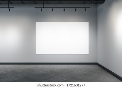 Modern interior with ceiling lamp and empty banner on gray concrete wall. Museum and exhibition concept. Mock up, 3D Rendering