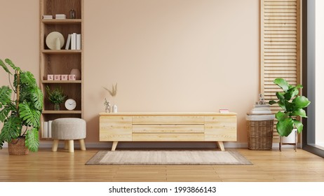 Modern interior of living room with cabinet for tv on cream color wall background,3d rendering