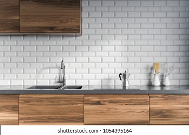 Modern kitchen interior with white brick walls, dark wooden countertops with a built in sink and a cooker. 3d rendering mock up