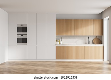 Moderno interior de cocina con paredes blancas, modernas encimeras con fregadero y cocina. 3.ª representación