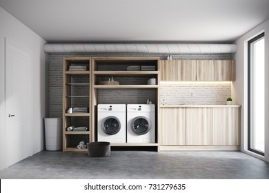 Modern laundry room interior with white brick walls, wooden consoles and shelves with two white washing machines. 3d rendering