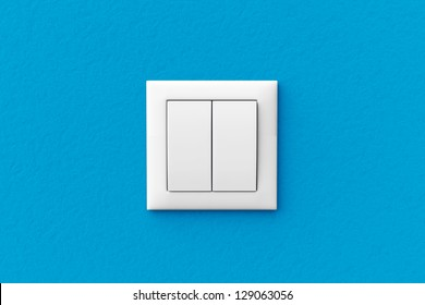 Modern light switch on a blue wall