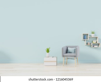Modern living room with blue armchair have cabinet and wood shelves on wood flooring and blue wall ,3d rendering