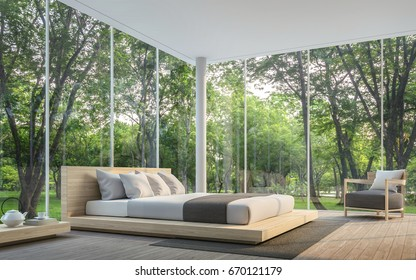 Modern living room with garden view 3d rendering Image.There are large window overlooking the surrounding garden and nature and finished with wooden furniture