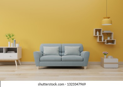 Modern living room interior with sofa and green plants,lamp,table on Yellow wall background. 3d rendering