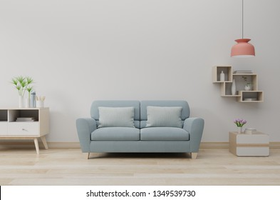 Modern living room interior with sofa and green plants,lamp,table on white wall background. 3d rendering