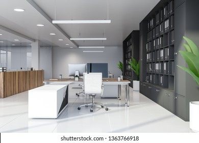 Modern manager office interior with white and glass walls, tiled floor, wooden computer desks and gray bookcases with folders. 3d rendering
