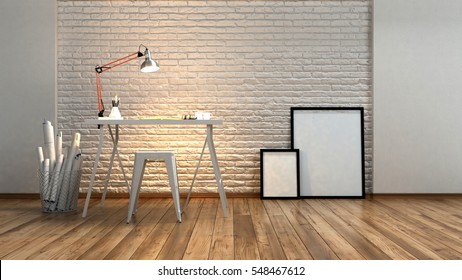 Modern minimalist studio or workstation with an anglepoise lamp illuminating a textured brick wall over a drafting or writing table with rolls of plans alongside and blank picture frames, 3d rendering