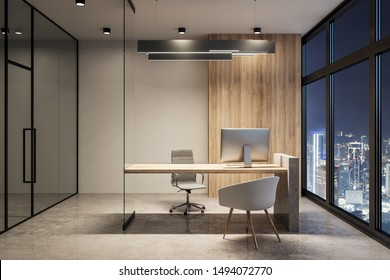 Modern office interior with equipment and night city view. Workplace concept. 3D Rendering