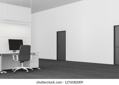 Modern office workplace interior with white walls, carpeted floor, white computer table with gray chair near it and gray doors in the wall. 3d rendering