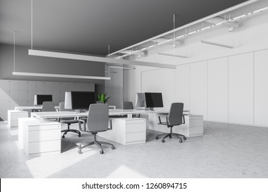 Modern office workplace with white and gray walls, stone floor, rows of white computer tables with chairs and lockers near the wall. 3d rendering