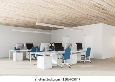 Modern open space office interior with wooden ceiling, rows of computer tables with black screen monitors and blue chairs. 3d rendering copy space