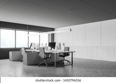 Modern open space office interior with gray and white walls, concrete floor, large windows and white computer desk. File cabinets near the wall. 3d rendering