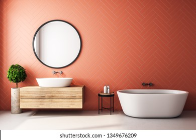 Modern orange bathroom interior with decorative tree, bath tub, sink, round mirror, sunlight and copy space. 3D Rendering