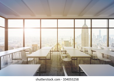A modern panoramic classroom with New York view. White tables and white chairs. 3D rendering. A sunset. Toned image.