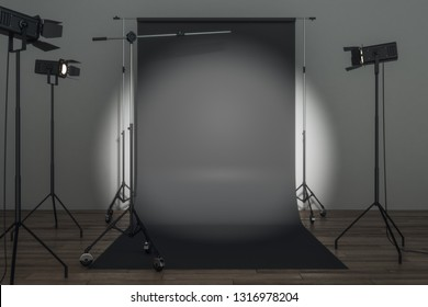 Modern photo studio with professional lighting equipment and black background. Photgraphy concept. Mock up, 3D Rendering
