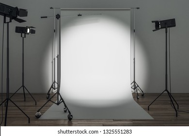 Modern photo studio with professional lighting equipment and white background. Photgraphy concept. Mock up, 3D Rendering