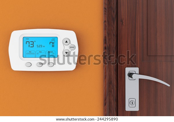 Modern Programming Thermostat on a wall near door
