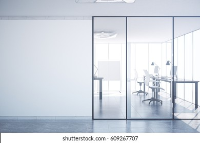 Modern simple office interior with glass doors, blank wall with copy space, city view and daylight. Mock up, 3D Rendering