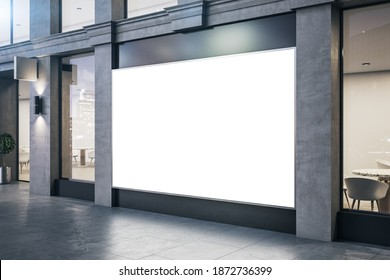 Modern store with blank billboard on vitrine and concrete columns. Advertisement and retail concept. Mock up, 3D Rendering