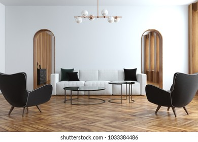 Modern white living room interior with a white sofa, narrow doorways and a wooden floor. Two black armchairs 3d rendering mock up