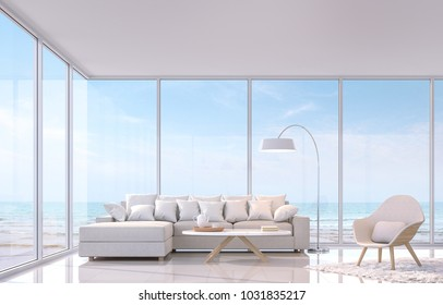 Modern white living room with sea view 3d rendering image.There are white tile floor and white glossy wall.Furnished with white furniture.There are large window overlooks to sea view.