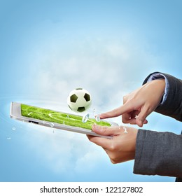 Modern wireless technology illustration with a computer device and football ball