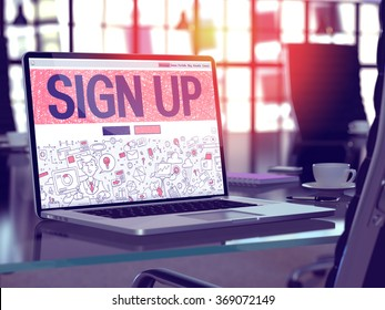 Modern Workplace with Laptop showing Landing Page in Doodle Design Style with text Sign Up. Toned Image with Selective Focus. 3d render.