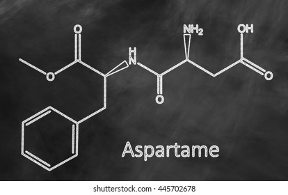 Molecular structure of artificial sweetener Aspartame (used in foods and beverages) on blackboard.