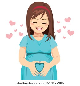 Mom making heart shape with hands on belly waiting her unborn baby