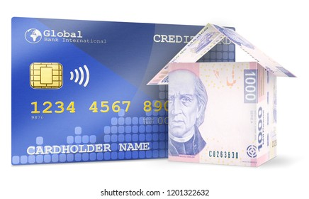 Money bills folded like houses standing next to a credit card symbolizing business concepts.
