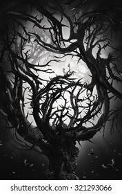 monochrome big mystic tree with thorns at night in moon light
