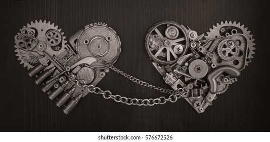 Monochrome Composition of two chained hearts collected from different mechanical parts. Valentines Day concept