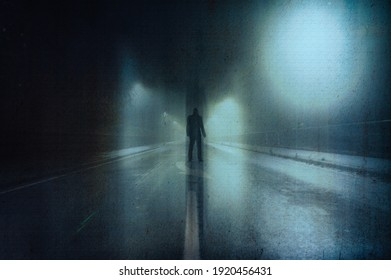 A moody figure, back to camera. Standing in a street on a foggy winters night. With a grunge, artistic, edit